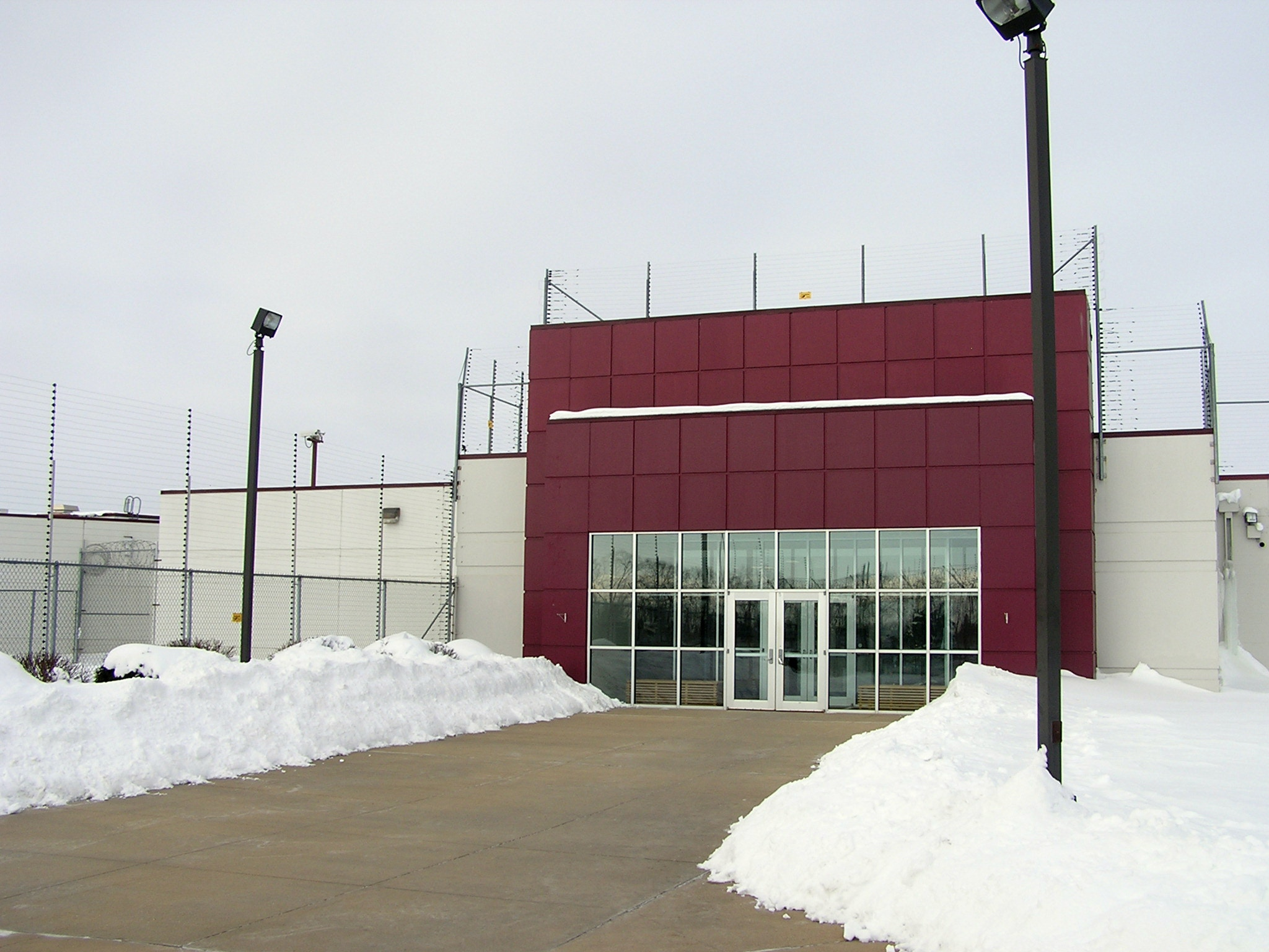 This photo taken Jan. 5, 2010, shows an entrance to the Prairie Correctional Facility, a private prison the closed in February 2010, in Appleton, Minn. State Republicans pushed legislation though a committee on Tuesday, March 26, 2016, to re-open the privately run prison in western Minnesota despite repeated interruptions from protesters who briefly halted debate as they pushed lawmakers to instead consider ways to decrease the state's prison population. (Mark Steil/Minnesota Public Radio via AP) MANDATORY CREDIT