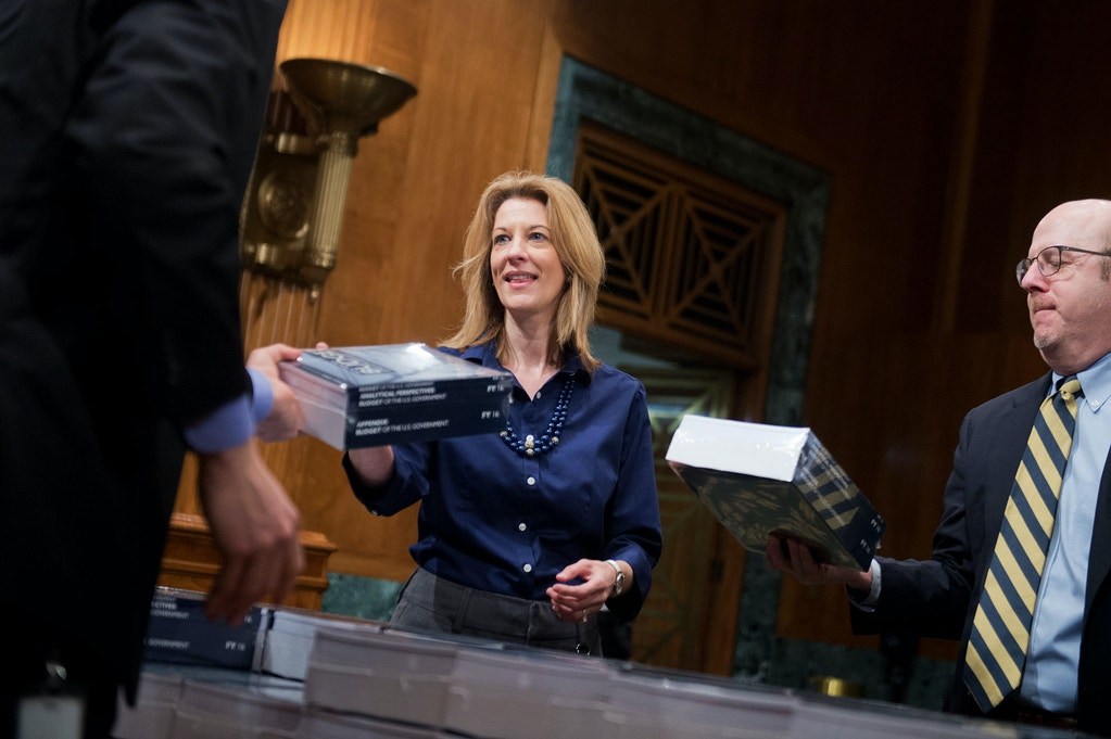 UNITED STATES - FEBRUARY 02: Stephanie Kelton, chief economist for the Senate Budget Committee's minority staff, picks up copies of President Obama's budget for fiscal year 2016, in Dirksen Building, February 2, 2015. (Photo By Tom Williams/CQ Roll Call) (CQ Roll Call via AP Images)