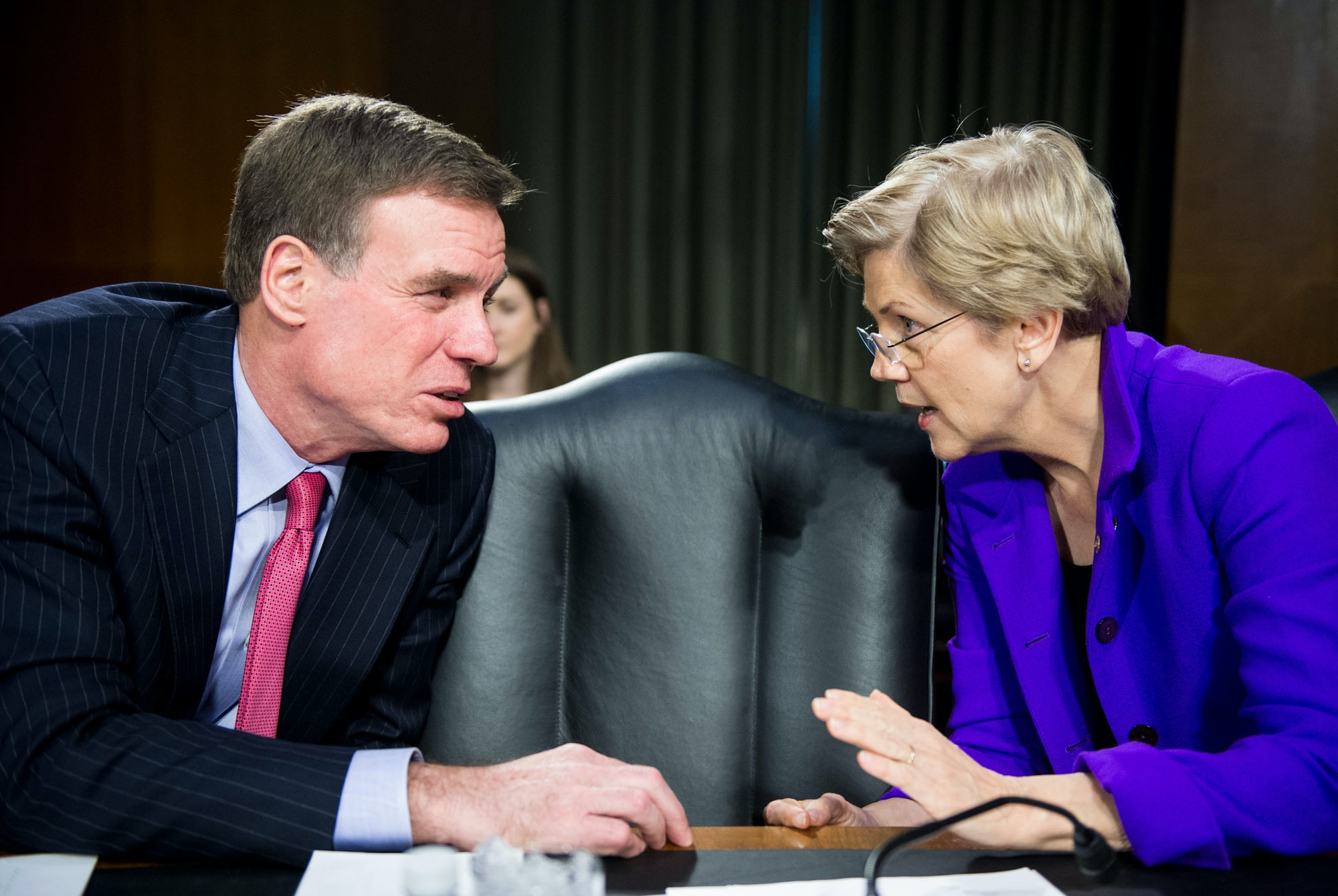 "UNITED STATES - FEBRUARY 24: Sen. Mark Warner, D-Va., and Sen. Elizabeth Warren, D-Mass., talk before the start of the Senate Banking, Housing and Urban Affairs Committee hearing on ""The Semiannual Monetary Policy Report to the Congress"" on Tuesday, Feb. 24, 2015. (Photo By Bill Clark/CQ Roll Call) (CQ Roll Call via AP Images)"