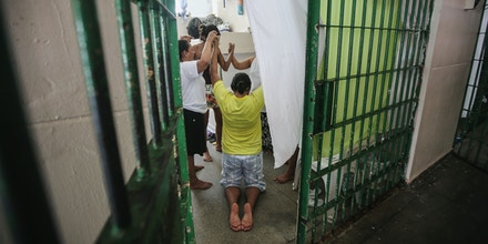 MANAUS, BRAZIL - FEBRUARY 17:  Inmates pray inside a cell in the women's section of the Anisio Jobim penitentiary complex on February 17, 2016 in Manaus, Brazil. The men's section of the prison holds over 1,200 inmates, more than twice as many as it was designed for. Brazil now holds the fourth-largest prison population in the world, behind the U.S., Russia and China, with the number of Brazilians behind bars nearly doubling in the past decade. The prison system currently holds more than 600,000 inmates, 61 percent over capacity, according to Human Rights Watch.  (Photo by Mario Tama/Getty Images)