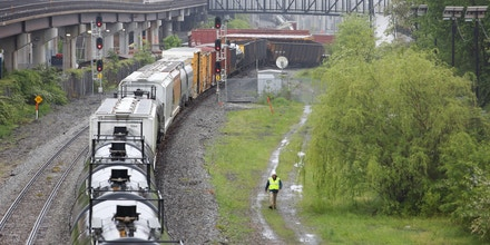 A CSX freight train is seen with several derailed cars near the Rhode Island Avenue metro station in Washington, DC, on May 1, 2016.As many as ten cars derailed from a train heading to North Carolina from Cumberland, Maryland.A leak of Sodium hydroxide was said to be leaking from a tanker, but was plugged by emergency responders and hazmat crews. / AFP / Andrew Biraj (Photo credit should read ANDREW BIRAJ/AFP/Getty Images)