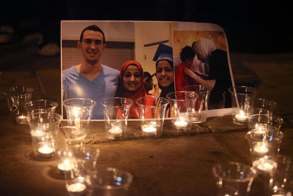AMMAN, JORDAN - FEBRUARY 16:  Candles are seen as a group of demonstrators gather in front of  American Embassy in Amman to protest against the Chapel Hill shooting, in Amman, Jordan on February 16, 2015. Three young Muslim students, Deah Shaddy Barakat, Yusor Mohammad, and Razan Mohammad Abu-Salha were killed on 10th of February 2015 in Chapel Hill, North Carolina, United States at their home on 10th of February 2015. A 46-year-old man was charged with the murder of three Muslim students who were fatally shot Tuesday at the University of North Carolinas residential complex in Chapel Hill, police said Wednesday. (Photo by Shadi Nsoor/Anadolu Agency/Getty Images)