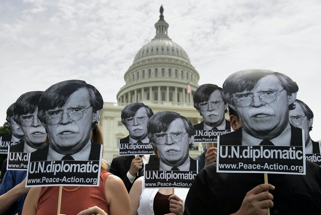 "WASHINGTON, UNITED STATES:  Activists gather on the west side of the US Capitol Building on Capitol Hill 07 June, 2005 in Washington, DC, to protest the nomination of John Bolton as US ambassador to the United Nations.  US President George W. Bush has condemned ""stall tactics"" used by opposition Democrats to hold up a Senate vote on the confirmation of Bolton, who has been accused of bullying staff and putting pressure on analysts to change intelligence to fit his political agenda.  AFP PHOTO/Brendan SMIALOWSKI  (Photo credit should read BRENDAN SMIALOWSKI/AFP/Getty Images)"