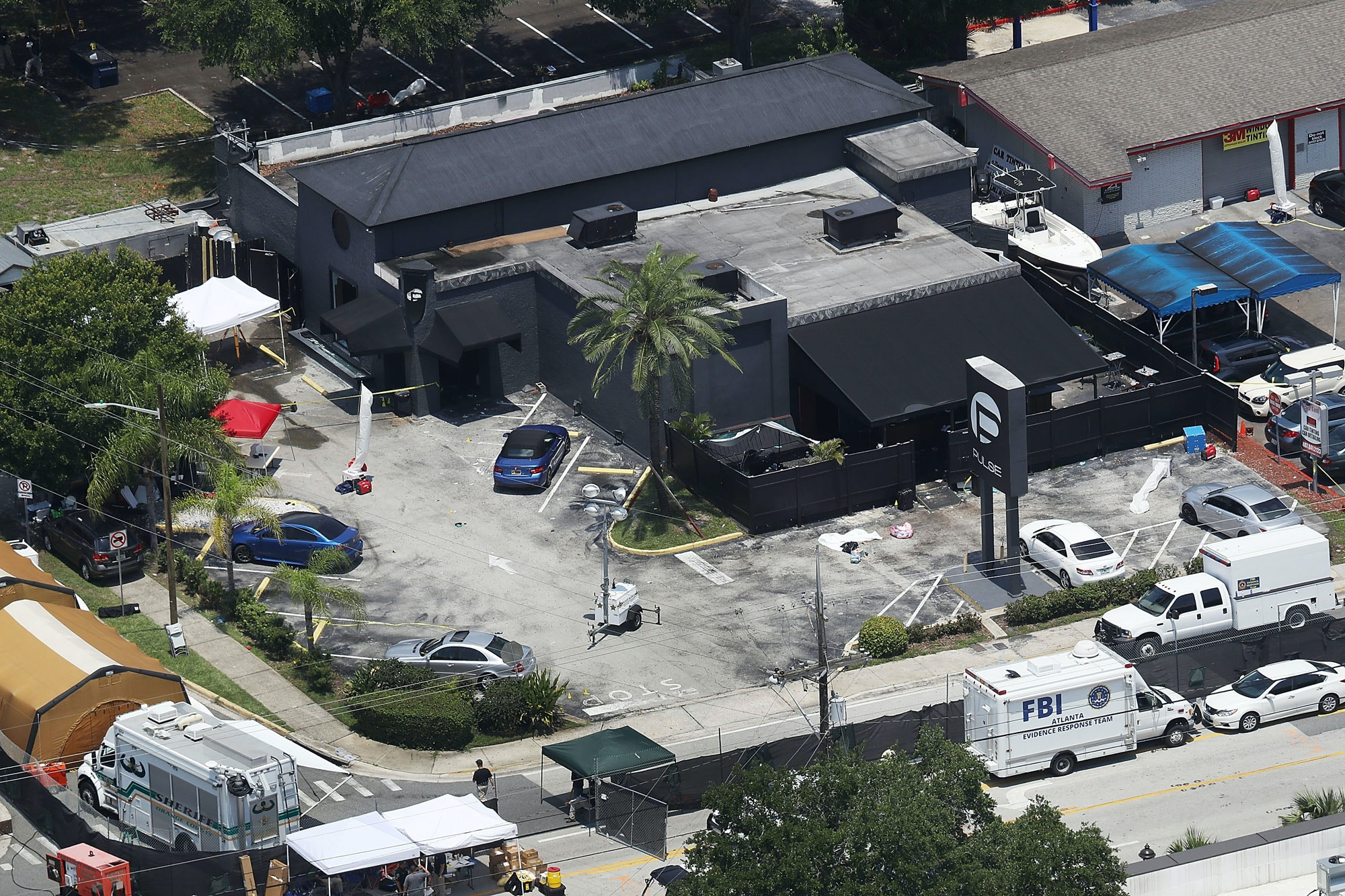 ORLANDO, FL - JUNE 13:  Law enforcement officials investigate at the Pulse gay nightclub where Omar Mateen allegedly killed at least 50 people on June 13, 2016 in Orlando, Florida. The mass shooting killed at least 50 people and injuring 53 others in what is the deadliest mass shooting in the country's history.  (Photo by Joe Raedle/Getty Images)