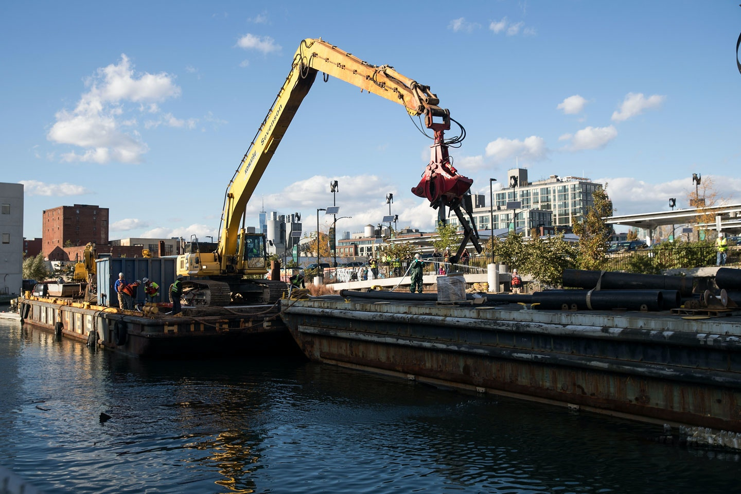 NEW YORK, NY - OCTOBER 24: A work crew contracted by the Environmental Protection Agency removes debris from the Gowanus Canal, October 24, 2016 in the Brooklyn borough of New York City. Formerly a bustling transportation and shipping route, the Gowanus Canal is now listed as one of the most polluted bodies of water in the United States. In 2010, the Gowanus Canal was declared a Superfund cleanup site by the U.S. Environmental Protection Agency. (Photo by Drew Angerer/Getty Images)