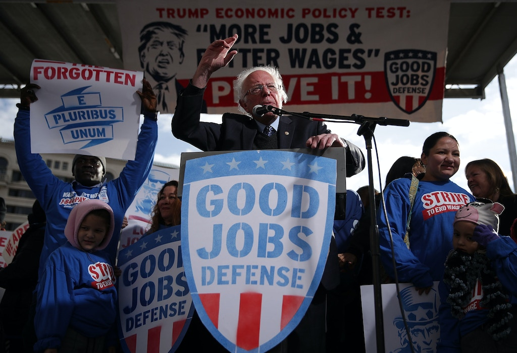 WASHINGTON, DC - DECEMBER 07:  U.S. Sen. Bernie Sanders (I-VT) (C) speaks during a rally on jobs December 7, 2016 at Freedom Plaza in Washington, DC. Our Revolution and Good Jobs Nation, the organizer, held a rally to demand good jobs and workers' rights from the incoming President-elect Donald Trump administration.  (Photo by Alex Wong/Getty Images)
