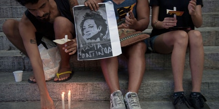 People light candles during a demonstration against the murder of councilwoman and activist Marielle Franco, in front of Rio de Janeiro's Legislative House on March 16, 2018. Brazilians mourned for second consecutive day a Rio de Janeiro councilwoman, black rights activist and outspoken critic of police brutality who was shot in an assassination-style killing on March 14. / AFP PHOTO / Mauro Pimentel (Photo credit should read MAURO PIMENTEL/AFP/Getty Images)