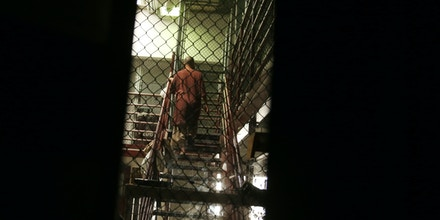 In this Feb. 2, 2016 photo, a detainee is seen going up the stairs at Camp 6 in the U.S. detention center at Guantanamo Bay, Cuba.  President Barack Obama's administration is working to reduce the number of men held at Guantanamo as it prepares to ask Congress to close it down. (AP Photo/Ben Fox)