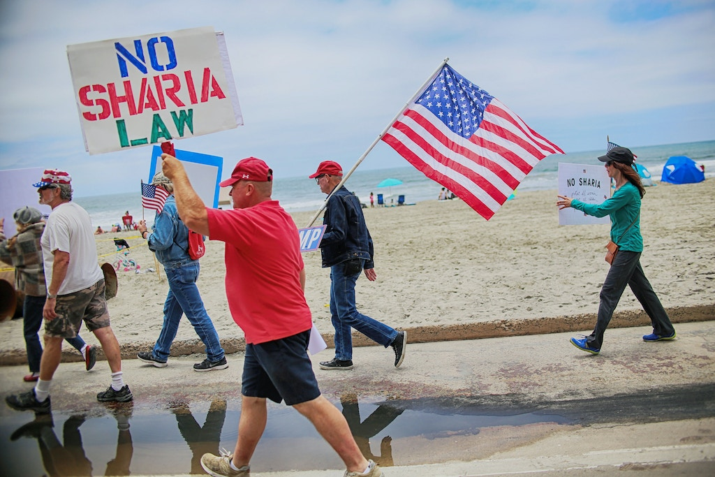 Anti Shariah Law demonstrators march along the beach during the March For Human rights and Against Sharia law demonstration in Oceanside, California on Saturday, June 10, 2017.Trump supporters held several rallies around the nation to bring attention to helping protect women and children from Sharia Law and its impact on Muslim women and children including honor killings and Female Genital Mutilation. / AFP PHOTO / Sandy Huffaker (Photo credit should read SANDY HUFFAKER/AFP/Getty Images)