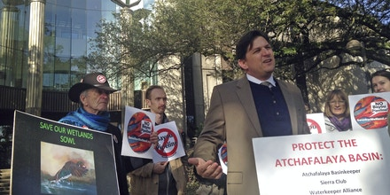 Scott Eustis, a community science director for the Gulf Restoration Network, speaks before a hearing in federal court in New Orleans, LA., Thursday, Feb. 8, 2018. A consortium of environmental groups sued the U.S. Army Corps of Engineers to halt construction of a pipeline through a river swamp in South Louisiana. The Bayou Bridge pipeline is designed to be the final segment of a pipeline network connecting the Bakken oil fields in North Dakota with Louisiana refineries and export terminals. (AP Photo/Michael Kunzelman)