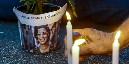 An elderly man lights a candle during a rally against the murder of Brazilian councilwoman and activist Marielle Franco, in Sao Paulo Brazil on March 15, 2018.Brazilians mourned for the Rio de Janeiro councilwoman and outspoken critic of police brutality who was shot in the city center in an assassination-style killing on the eve. / AFP PHOTO / Miguel SCHINCARIOL (Photo credit should read MIGUEL SCHINCARIOL/AFP/Getty Images)