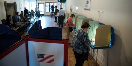 Two people cast their vote at the Early Vote Center in northeast Minneapolis, Minnesota on October 5, 2016.Voters in Minnesota can submit their ballot for the General Election at locations across the state every day until Election Day on November 8, 2016. / AFP / STEPHEN MATUREN (Photo credit should read STEPHEN MATUREN/AFP/Getty Images)
