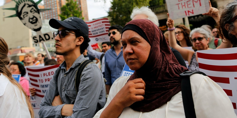 People take part in a rally to protest restrictive guidelines issued by the US on who qualifies as a close familial relationship under the Supreme Court order on the Muslim and refugee ban at Union Square on June 29, 2017, in New York.US President Donald Trump's five-month effort to implement a promised ban on travelers from six mostly Muslim countries and on all refugees takes effect late Thursday, July 29, 2017 as controversy swirls over who qualifies for an exemption based on family ties. / AFP PHOTO / EDUARDO MUNOZ ALVAREZ (Photo credit should read EDUARDO MUNOZ ALVAREZ/AFP/Getty Images)