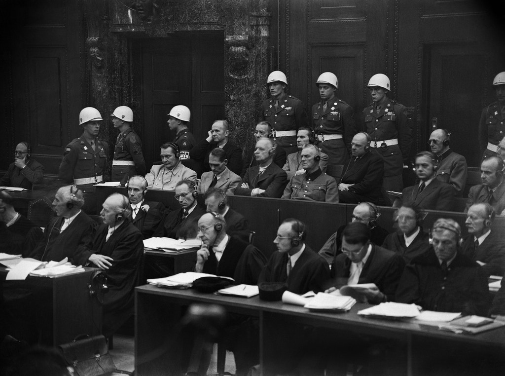 View of some of the nazi leaders accused of war crimes during the world war II during the war crimes trial at Nuremberg International Military Tribunal (IMT) court, held between November 20, 1945 and October 1, 1946. (From L to R) At the first row, Hermann Goering, Rudolf Hess, Joachim von Ribbentrop, Wilhelm Keitel, Ernst Kaltenbrunner, at the Second row, Karl Doenitz, Erich Raeder, Baldur Von Schirach, Fritz Sauckel.  AFP PHOTO        (Photo credit should read STRINGER/AFP/Getty Images)
