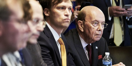 Wilbur Ross, U.S. commerce secretary, right, listens during a meeting with U.S. President Donald Trump and steel and aluminum executives in the Cabinet Room of the White House in Washington, D.C., U.S., on Thursday, March 1, 2018. Trump said the U.S. will slap tariffs on steel and aluminum imports to protect national security, a major escalation of his hawkish trade agenda that could hit producers from Europe to Asia and spur global retaliation. Photographer: T.J. Kirkpatrick/ Bloomberg