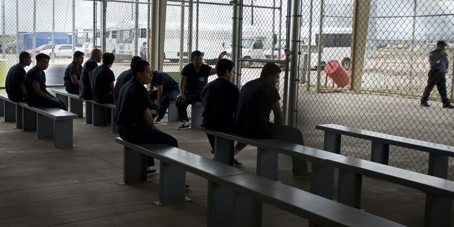 Raymondville, UNITED STATES: Detainees wait to be processed inside Homeland Security's Willacy Detention Center, a facility with 10 giant tents that can house up to 2000 detained illegal immigrants, 10 May 2007 in Raymondville, Texas. The 65 million USD facility was constructed as part of Secure Border Initative last July and now where many of the former