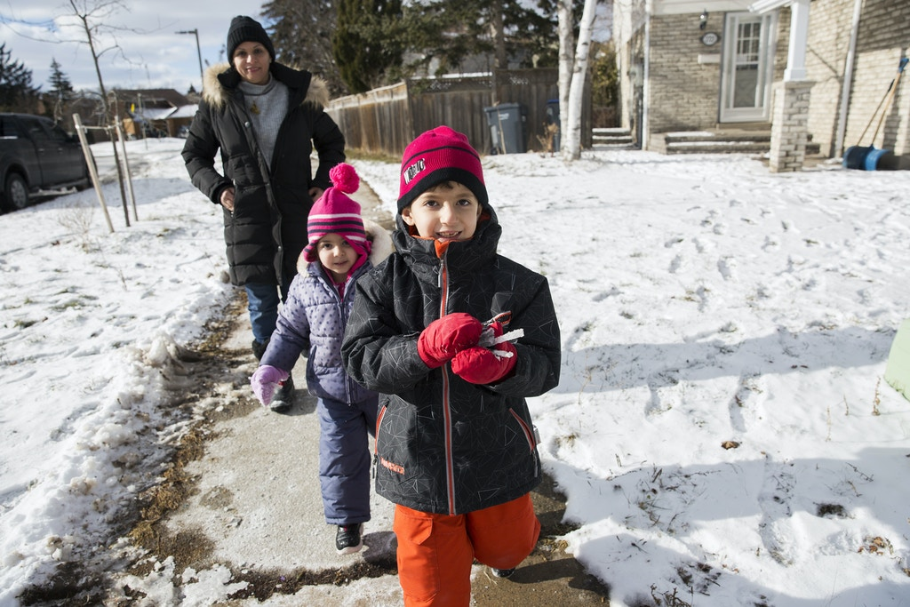 Iraqi refugee  Zinah al Shakarchi with her children Yousif and Sidrah in Mississauga, Ontario on Sunday, Jan. 14, 2018.