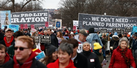 Anti-abortion activists march up Constitution Avenue en route to the Supreme Court in Washington, Friday, Jan. 27, 2017, during the 44th annual March For Life. (AP Photo/Carolyn Kaster)