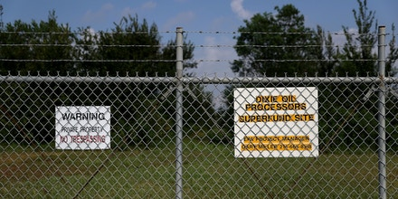 FRIENDSWOOD, TX - SEPTEMBER 04:  A sign is posted on a fence at the Dixie Oil Processors Superfund site on September 4, 2017 in Friendswood, Texas. 13 of the 41 Superfund sites in Texas remain flooded following Hurricane Harvey but it is unclear if chemicals and pollutants from the the facilities were able to escape in floodwaters. Over a week after Hurricane Harvey hit Southern Texas, residents are beginning the long process of recovering from the storm.  (Photo by Justin Sullivan/Getty Images)