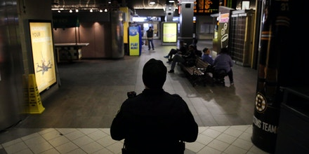 BOSTON, MA - MARCH 22: Transit police officer Nuno Almeida patrols North Station in Boston on Mar. 22, 2016. (Photo by Craig F. Walker/The Boston Globe via Getty Images)