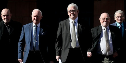 'Hooded men' torture case. Five of the 'Hooded' men, who were kept in hoods interned in Northern Ireland in 1971, Francie McGuigan (centre)with (from left) Patrick McNally, Liam Shannon, Davy Rodgers, and Brian Turley following a press conference at KRW Law in Belfast, after the European Court of Human Rights delivered its judgement on the treatment of the 'Hooded' men. Picture date: Tuesday March 20, 2018. See PA story IRISH Hooded. Photo credit should read: Brian Lawless/PA Wire URN:35611799