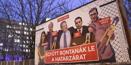 BUDAPEST, HUNGARY - MARCH 20:  A Fidesz-party sponsored poster featuring a montage of billionaire investor George Soros (C) posing with (L to R) Politics Can Be Different (Lehet Mas a Politika, or LMP) party candidate Bernadett Szel, former Hungarian prime minister and Democratic Coalition (Hungarian: Demokratikus Koalicio, or DK) party candidate Ferenc Gyurcsany, Jobbik party candidate Gabor Vona, and Dialogue for Hungary (Parbeszed Magyarorszagert) party candidate Gergely Karacsony, all holding bolt cutters after having cut the border fence behind them, hangs prior to the upcoming Hungarian parliamentary elections on April 8, on March 20, 2018 in Budapest, Hungary. Incumbent Prime Minister Viktor Orban faces only a few disorganized opposition parties standing in the way of a possible third term, although the popularity of his own, Fidesz, once a liberal student movement and now advocating an increasingly anti-immigrant, anti-European Union platform after dominating Hungarian politics on both national and local levels since 2010, has fallen since December. It suffered a surprising setback last month in its southern town stronghold of Hodmezovasarhely, when an opposition-backed independent won an easy victory, giving hope to other contenders for success in the national elections in early April.  (Photo by Adam Berry/Getty Images)
