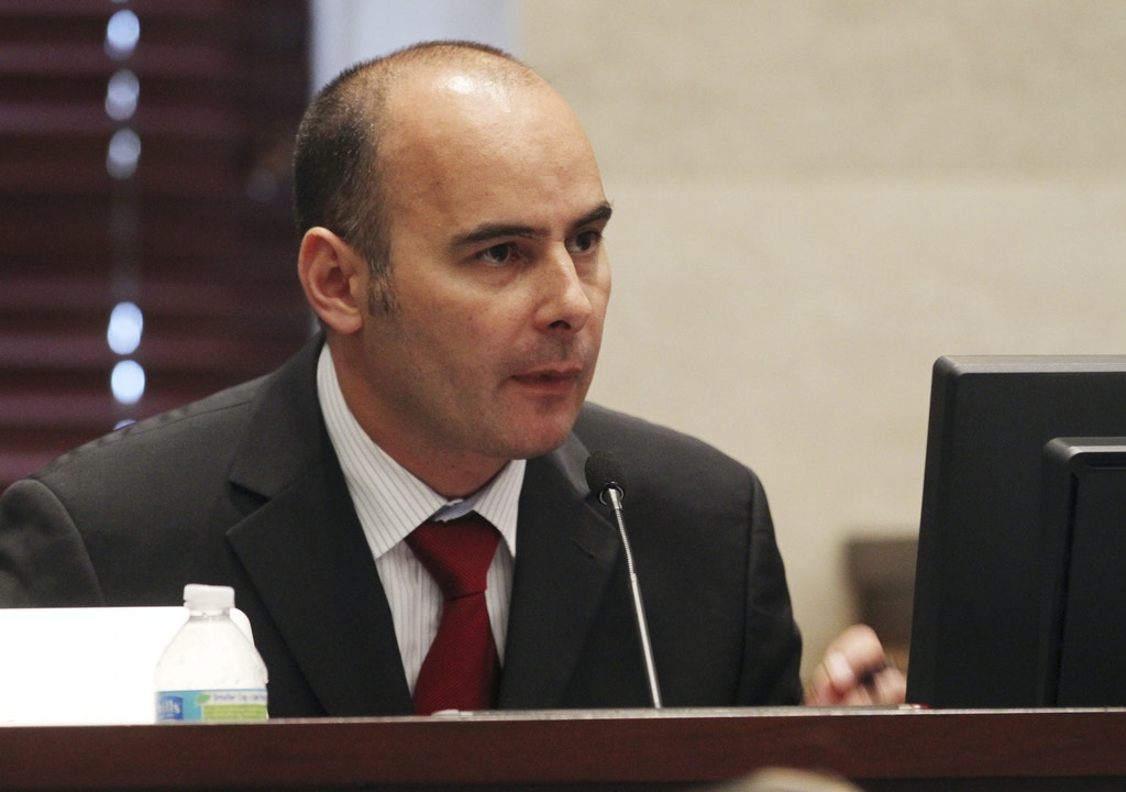 Dr. Richard Eikelenboom sits on the witness stand during the Casey Anthony murder trial at the in Orlando, Fla. on Tuesday, June 21, 2011. Eikelenboom was being questioned without the jury present about how his deposition and investigation was compiled for the defense team. Anthony is charged with killing her daughter, Caylee. (AP Photo/Red Huber, Pool)