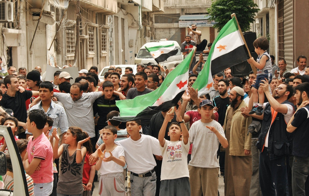 Protesters wave Syrian revolutionary flags during a demonstration at al-Hamra neighborhood in Homs, Syria, Friday, May 11, 2012. A Syrian opposition leader said Friday the regime is trying to destroy a U.N.-brokered peace plan for the country. (AP Photo)
