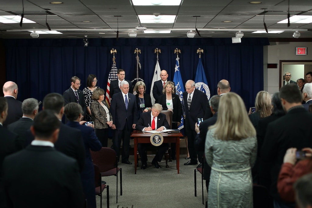 United States President Donald Trump (C) signs four executive orders during a visit to the Department of Homeland Security with Vice President Mike Pence, Homeland Security Secretary John Kelly and other officials January 25, 2017 in Washington, DC. Trump signed four executive orders related to domestic security and to begin the process of building a wall along the U.S.-Mexico border. Credit: Chip Somodevilla / Pool via CNP - NO'WIRE'SERVICE - Photo by: Chip Somodevilla/picture-alliance/dpa/AP Images