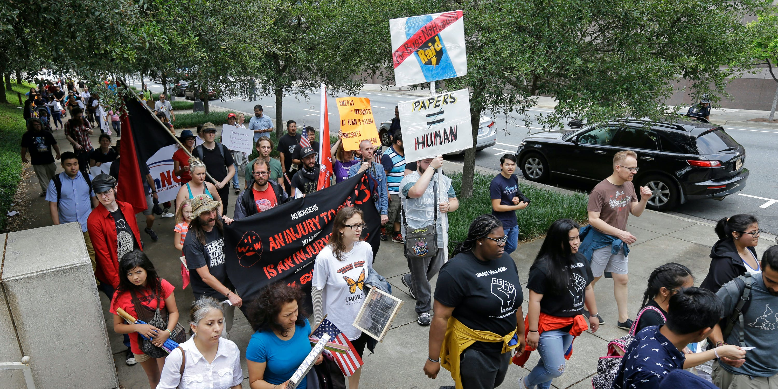 Protesters march during a rally in support of undocumented immigrants in Charlotte, N.C., Monday, May 1, 2017. (AP Photo/Chuck Burton)