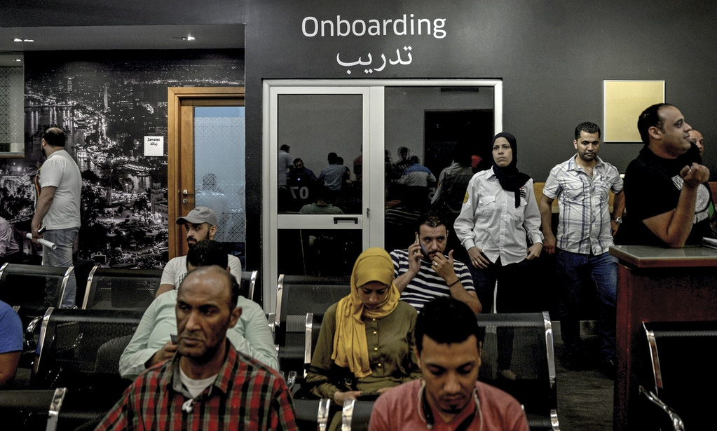 Uber drivers sit in a service and training center of the company in Cairo, Egypt, 11 May 2017. Since the transport company Uber entered the most populous market of the Arabic world in autumn 2014, more than 50,000 drivers have already applied. Photo by: Gehad Hamdy/picture-alliance/dpa/AP Images