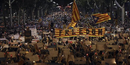 FILE - In this Tuesday, Oct. 17, 2017 file photo people gather to protest against the National Court's decision to imprison civil society leaders without bail, in Barcelona, Spain. (AP Photo/Emilio Morenatti, File)