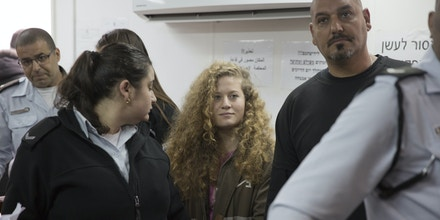 Palestinian protest icon Ahed Tamimi is in a courtroom at the Ofer military prison near Jerusalem, Tuesday, Feb. 13, 2018. The Israeli military judge overseeing the trial of Palestinian teenager Tamimi has ordered all proceedings to take place behind closed doors. (AP Photo/Ariel Schalit)