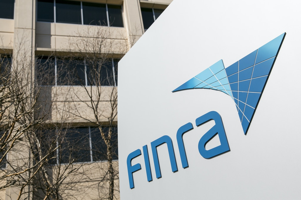 A logo sign outside a facility occupied by the Financial Industry Regulatory Authority (FINRA), in Rockville, Maryland on April 4, 2015. Photo credit: Kristoffer Tripplaar/ Sipa USA *** Please Use Credit from Credit Field ***