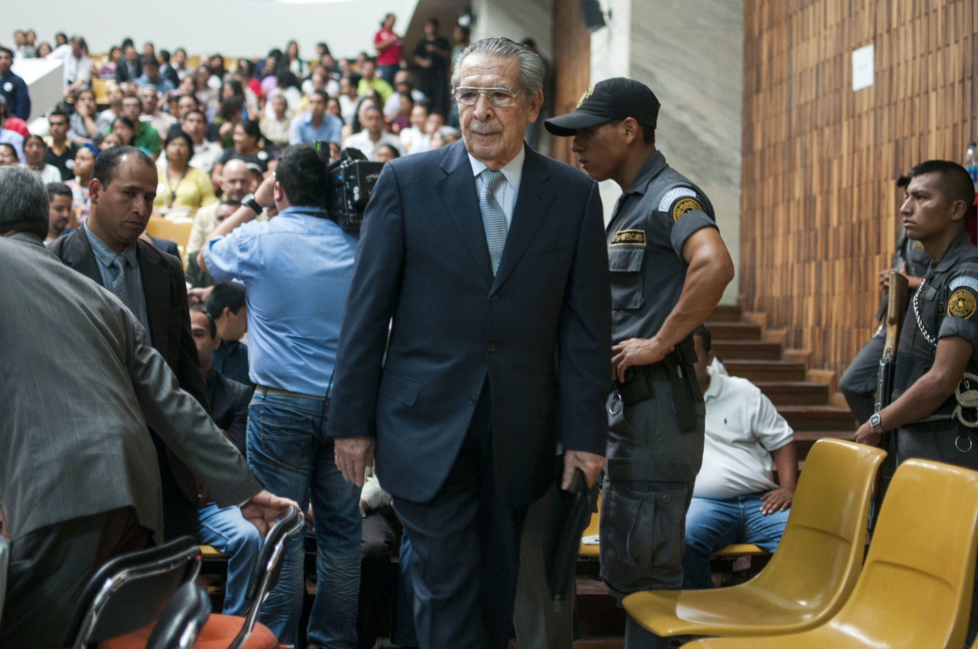 Guatemala's former dictator General Efraín Ríos Montt enters the court after Tribunal President Yasmin Barrios announced that judges overseeing the trial will not accept another judge's ruling that the case should start over, one day after a judge ordered the suspension of the genocide trail against Rios Montt and General Jose Mauricio Rodriguez Sanchez in Guatemala City, Friday, April 19, 2013. Rios Montt seized power in a March 23, 1982 coup, and ruled until he himself was overthrown just over a year later. Prosecutors say that while in power he was aware of, and thus responsible for, the slaughter by subordinates of at least 1,771 Ixil Mayas in San Juan Cotzal, San Gaspar Chajul and Santa Maria Nebaj, towns in the Quiche department of Guatemala's western highlands. (AP Photo/Luis Soto)