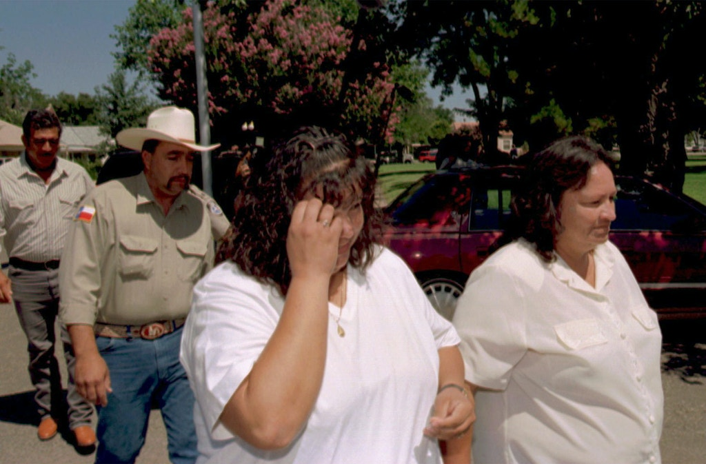 From left, Esequiel Hernandez Sr, father;  Margarito Hernandez, brother; Belen Hernandez, sister); and Maria de La Luz Hernandez, mother, walk  outside a Marfa, Texas courthouse Thursday, Aug. 14, 1997 after a grand jury declined to indict Marine Cpl. Clemente Banuelos who shot and killed their family member, 18-year old Esequiel Hernandez, Jr. May 22, 1997. (AP Photo/Walter Frerck)