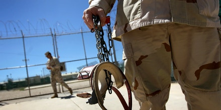 GUANTANAMO BAY, CUBA - SEPTEMBER 16:  (EDITORS NOTE: Image has been reviewed by the U.S. Military prior to transmission.) A U.S. military guard carries shackles before moving a detainee inside the U.S. detention center for