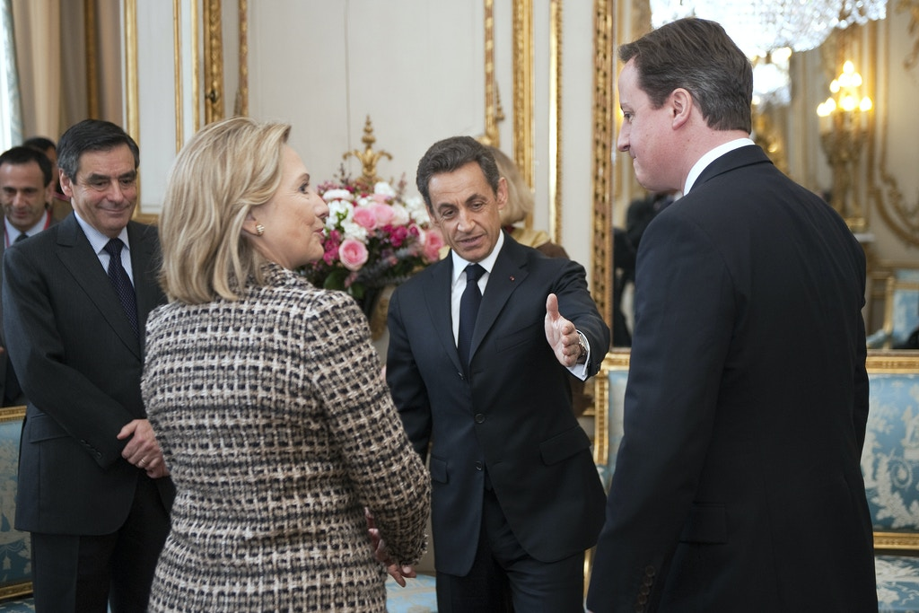 France's president Nicolas Sarkozy (C) speaks with British Prime minister Davd Cameron (R) US Secretary of State Hillary Clinton (2ndL) and France Prime Francois Fillon (L) on March 19, 2011, before a summit at the Elysee Palace in Paris, on implementing the UN Security Council resolution 1973 authorising military action in Libya, to be attended by representatives of the European Union, the Arab League, the African Union, the UN and other leaders. A senior French envoy predicted military action against Libyan leader Moamer Kadhafi's forces within hours of the summit. The United States has also declared that Kadhafi is in breach of a UN Security Council resolution which ordered an immediate ceasefire. AFP PHOTO POOL LIONEL BONAVENTURE (Photo credit should read LIONEL BONAVENTURE/AFP/Getty Images)