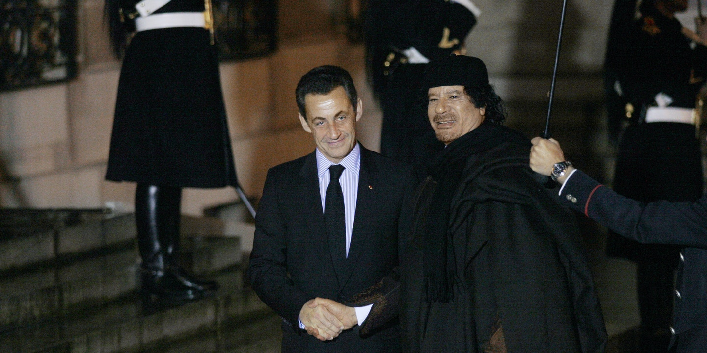 FRANCE - DECEMBER 10: Mouammar Kadhafi and French President Nicolas Sarkozy arriving for a dinner at the Elysee Palace in Orly, France on December 10th, 2007. (Photo by Thomas SAMSON/Gamma-Rapho via Getty Images)