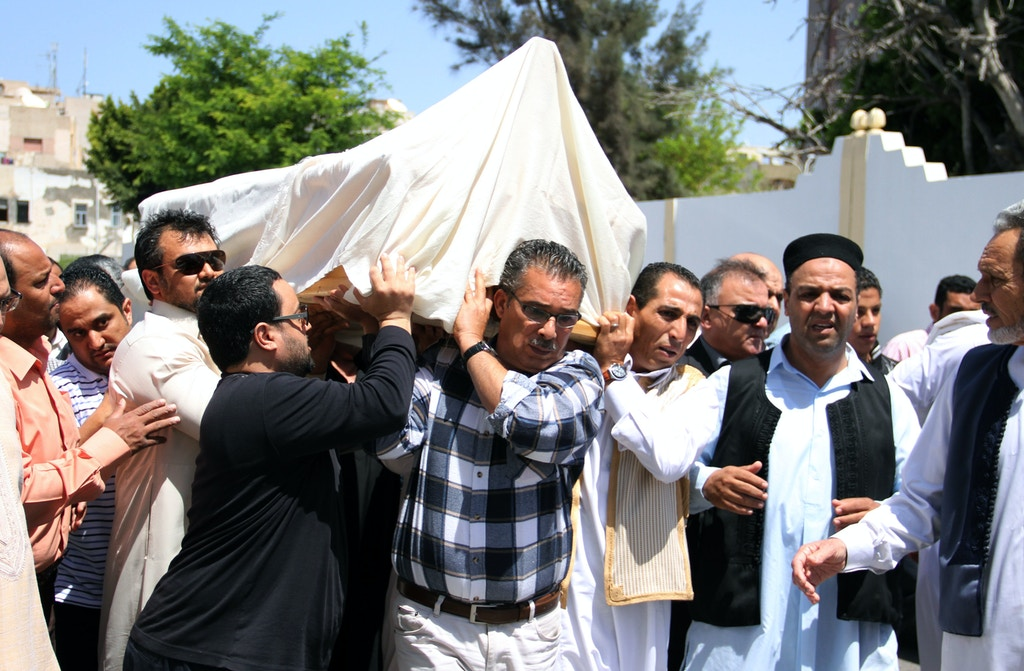 "The body of former Libyan oil minister Shukri Ghanem, who was found dead in the Danube river in Vienna late last month, is carried during his funeral in the Libyan capital Triploli on may 4, 2012. Preliminary medical reports issued by Austrian police suggested that Ghanem drowned with ""no signs of involvement by another party."" AFP PHOTO/STR        (Photo credit should read -/AFP/GettyImages)"