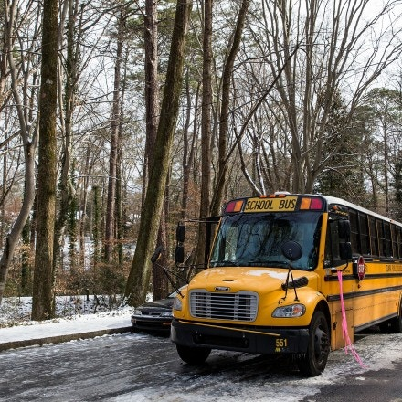 ATLANTA, GA - JANUARY 29: An abandoned Atlanta Public School bus sits in the ice on Howell Mill Road during the winter storm January 29, 2014 in Atlanta, Georgia. Drivers and kids on school buses were stuck in their vehicles overnight as the wintery weather and accidents snarled roads and highways thoughout the region.  (Photo by Daniel Shirey/Getty Images)