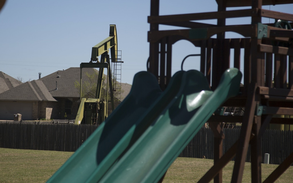 OKLAHOMA CITY, OK - MARCH 31: A pump jack is located near a play ground March 31, 2016 near Oklahoma City, Oklahoma. The United States Geological Survey  estimates over 7 million people live in areas at risk of human-induced earthquake damage. Oklahoma has been slow to recognize the connection between earthquakes and the disposal of toxic wastewater. (Photo by J Pat Carter/Getty Images)