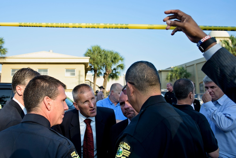 Ronald Hopper (3L), FBI Tampa division Assistant Agent in Charge, talks to Orlando Police Chief John Mina (2L), Orlando Police Chief, Paul Wysopal (4L), FBI Tampa Division Special Agent in Charge, and others near the Pulse nightclub June 13, 2016 in Orlando, Florida.<br /><br /><br /><br /><br /><br /><br /><br /><br /><br /><br /><br /><br /><br /><br /> Forty-nine people and the shooter died and more than 50 were injured when a gunman opened fire and seized hostages at a gay nightclub in Florida, police said June 12, making it the worst mass shooting in US history. / AFP / Brendan Smialowski        (Photo credit should read BRENDAN SMIALOWSKI/AFP/Getty Images)