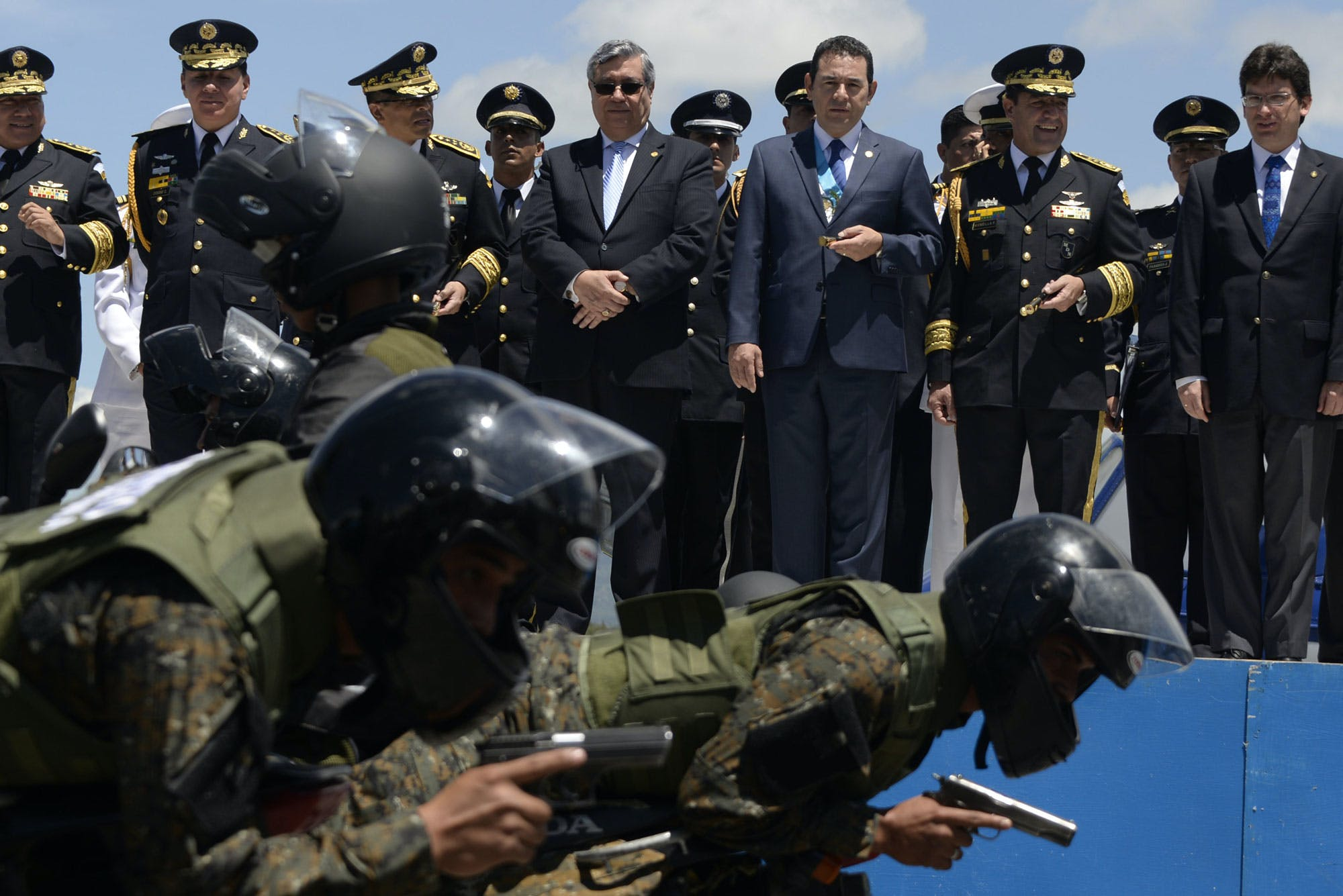 Guatemalan President Jimmy Morales (3-R) attends a military parade during the celebration of the Army Day in Guatemala City, on July 3, 2016. / AFP / JOHAN ORDONEZ (Photo credit should read JOHAN ORDONEZ/AFP/Getty Images)