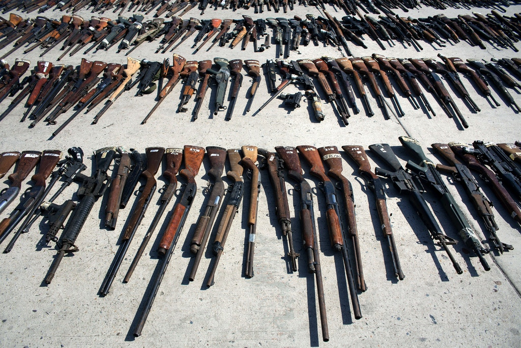Hundreds of firearms are displayed before being destroyed at the Morelos military headquarters in Tijuana, Mexico, on August 12, 2016.  According to the Army, the thousands weapons were obtained in several seizures and handed in by citizens during Mexico`s firearm exchange programmme.  / AFP / GUILLERMO ARIAS        (Photo credit should read GUILLERMO ARIAS/AFP/Getty Images)