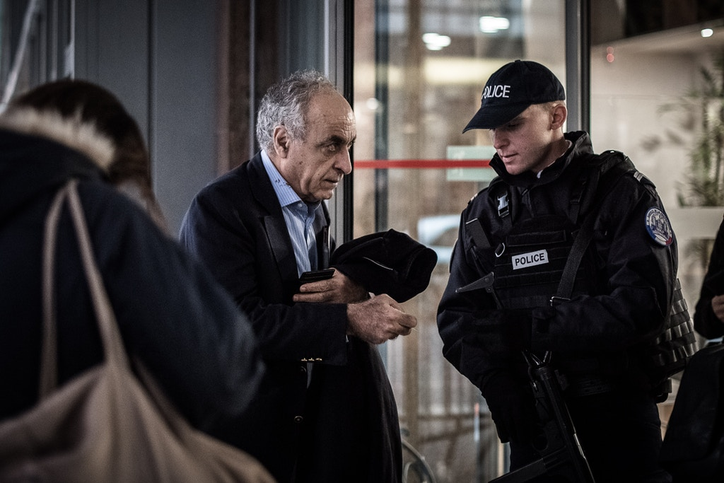 Franco-Lebanese businessman Ziad Takieddine shows a document to a policeman as he arrives at the anti-corruption police office (OCLCIFF) in Nanterre, on November 17, 2016, for his hearing after he admitted delivering three cash-stuffed suitcases from the Libyan leader toward French former President Nicolas Sarkozy.Nicolas Sarkozy's links with the late Moamer Kadhafi came under fresh scrutiny on November 15, 2016 after Ziad Takieddine admitted delivering three cash-stuffed suitcases from the Libyan leader toward the Frenchman's first presidential bid. In an interview with the Mediapart investigative news site, Takieddine said he had made three trips from Tripoli to Paris in late 2006 and early 2007 with cash for Sarkozy's campaign. / AFP / PHILIPPE LOPEZ (Photo credit should read PHILIPPE LOPEZ/AFP/Getty Images)