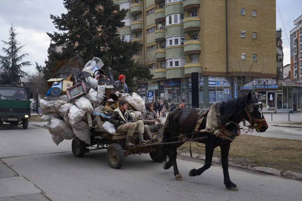 "MITROVICA, KOSOVO - FEBRUARY 20: Teenagers ride a cart in the Albanian part of Mitrovica as the new US Trump administration reaffirms its support for a stable Kosovo, the newest European state and former region of Serbia on February 20, 2017 in Mitrovica, Kosovo. Tensions escalated between Serbia and Kosovo after a failed attempt of Serbia to send a train to Kosovo painted in the colors of the Serbian national flag with the text ""Kosovo is Serbia"". (Photo by Pierre Crom/Getty Images)"