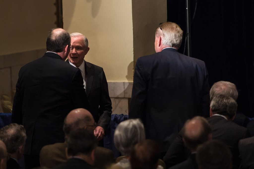 Senator Jeff Sessions (R-AL) (2L) speaks with a guest while Russian Ambassador to the US Sergey Kislyak (front row R) waits to hear Republican US Presidential hopeful Donald Trump speak about foreign policy at the Mayflower Hotel April 27, 2016 in Washington, DC. / AFP PHOTO / Brendan Smialowski        (Photo credit should read BRENDAN SMIALOWSKI/AFP/Getty Images)