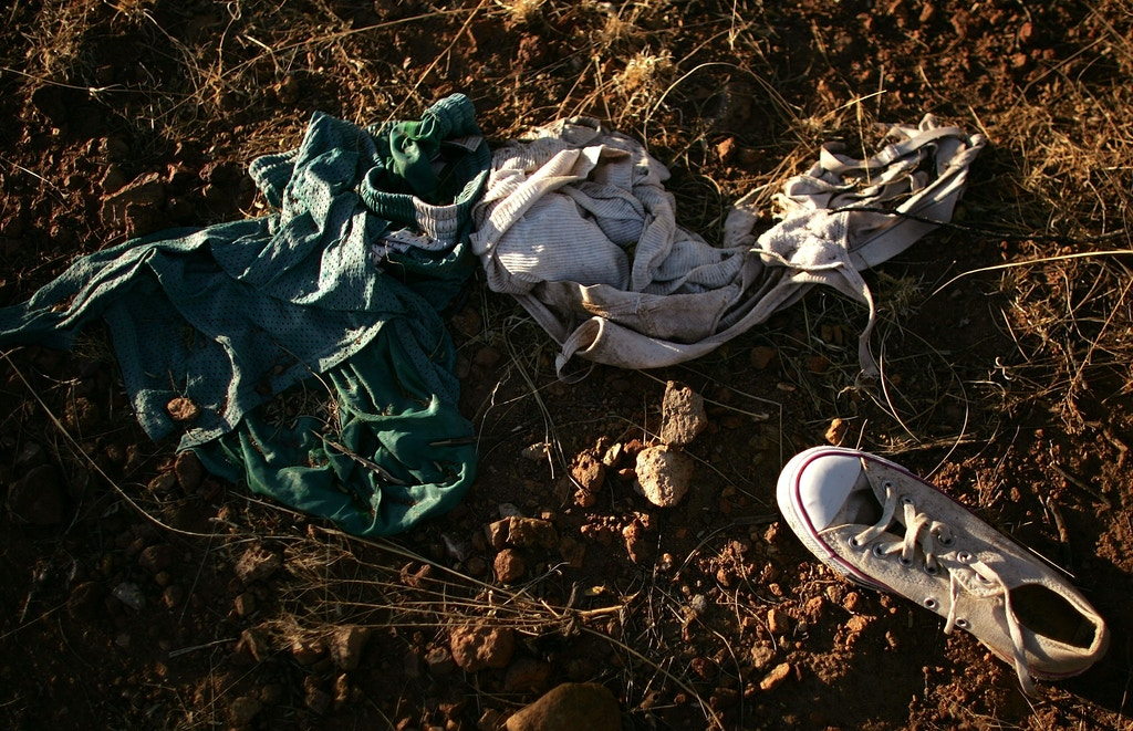 PIMA COUNTY, ARIZONA - JUNE 16:  Discarded clothes and a sneaker lay on the ground on a trail used by migrants entering the U.S. illegally from Mexico June 16, 2006 in Pima County, Arizona. Since 1998 over 2,650 men, women and children have died attempting to cross the U.S.-Mexico border. According to the U.S. Border Patrol, a record 473 illegal immigrants died while trying to cross the U.S.-Mexico border during the fiscal year that ended September 30, 2005. The group No More Deaths runs 24-hour camps in the desert conducting search and rescue patrols for migrants in peril.  (Photo by Spencer Platt/Getty Images)