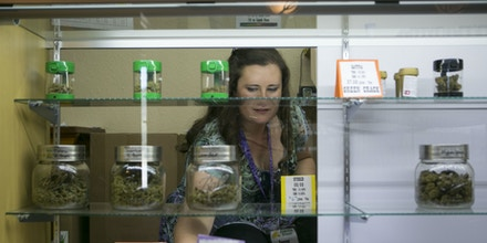 SUMPTER, OR - JULY 02: Owner of the Sumpter Nugget dispensary, Jenny Long restocks inventory July 2, 2017 in Sumpter, Oregon. City leaders had a chance to opt out of having recreational marijuana stores within their area until the end of 2015, per state rules. But around that time, councilors were wrapped up in other issues and basically forgot to opt out. Sensing a business opportunity, Long opened the first dispensary with her husband Justin, sensing a business opportunity as there are so few dispensaries in Eastern Oregon. Patrons come from Idaho as well, where recreational marijuana is illegal. (Photo By Natalie Behring/Getty Images)